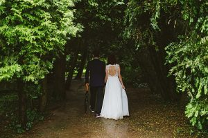 Wedding Trends: Campsite Weddings - event planning expert advice - Wedding_walk_dark_forest_path